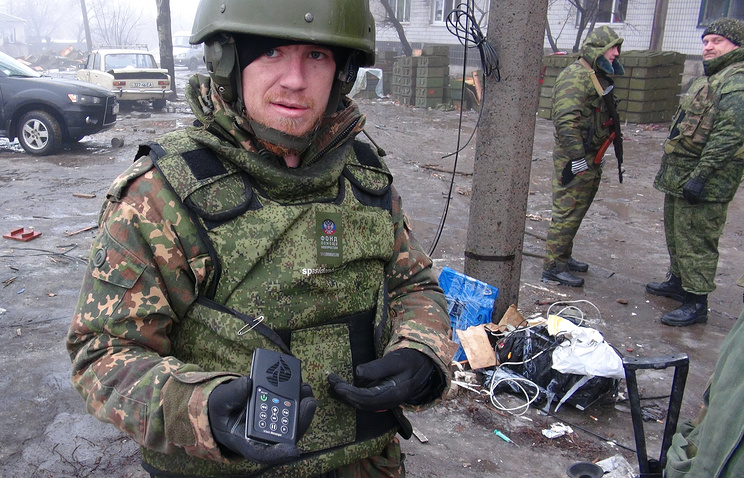 Militia fighter shows an audio player with preaching messages found in the debris of the destroyed Donetsk Airport