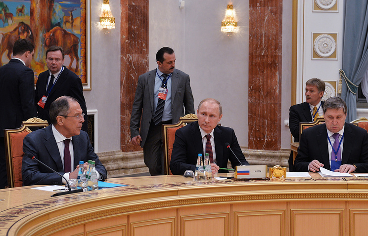 Russia's foreign minister Sergei Lavrov, president Vladimir Putin, his aide Yuri Ushakov and Putin's spokesman Dmitry Peskov during Ukraine peace talks in Minsk