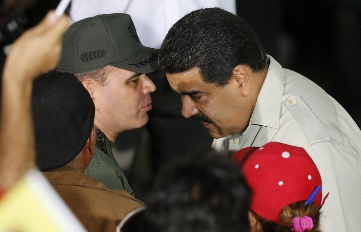 Venezuela's President Nicolas Maduro talks to the defense minsiter after the special operation to arrest Antonio Ledesma