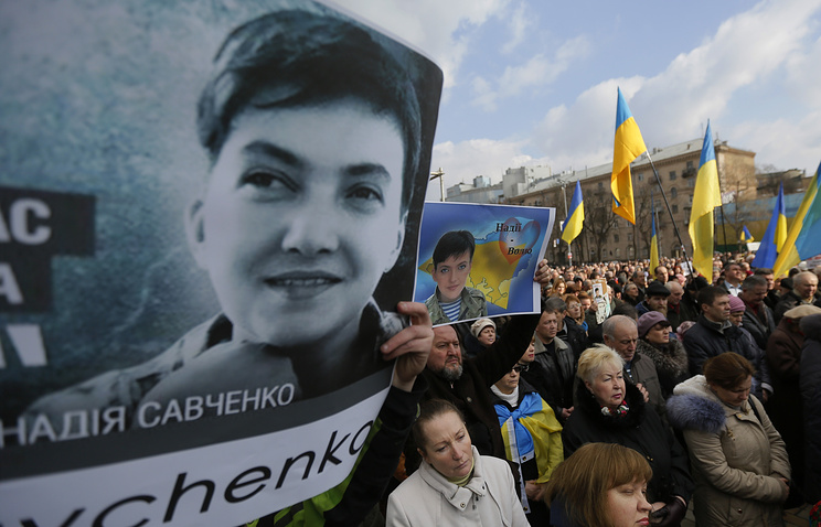 A portrait of Nadezhda Savchenko seen at a rally in Kiev