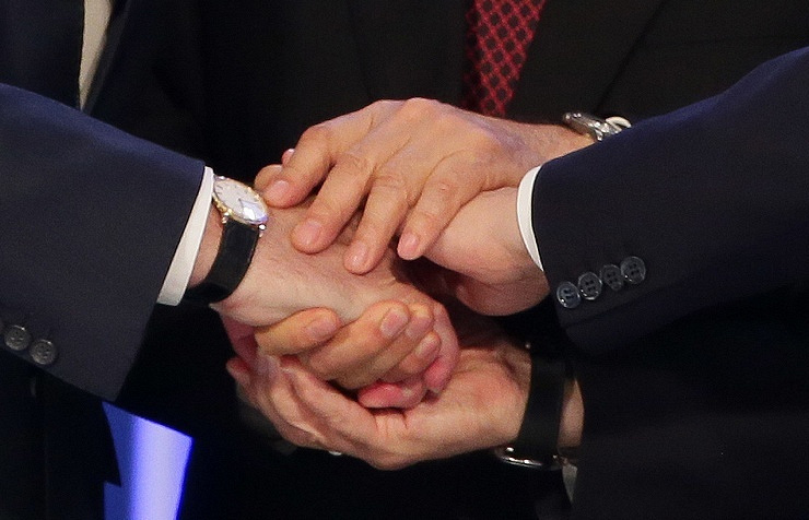 Presidents of Russia, Belarus and Kazakhstan shake hands after signing the treaty on creation of the EEU