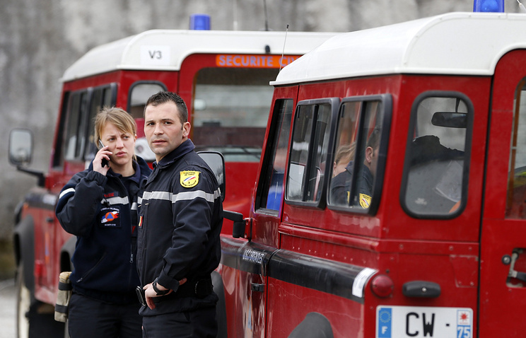 Members of the French Fire Service near the crash site of the Germanwings Airbus A320 in the French Alps