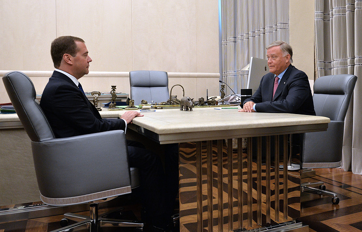 Russian Prime Minister Dmitry Medvedev and Russian Railways CEO Vladimir Yakunin