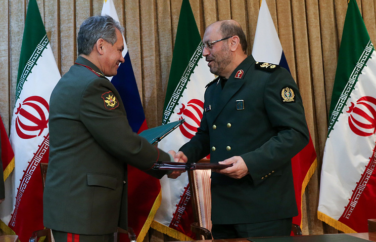 Russia's and Iran's Defense Ministers Sergei Shoigu and Hosein Dehqan