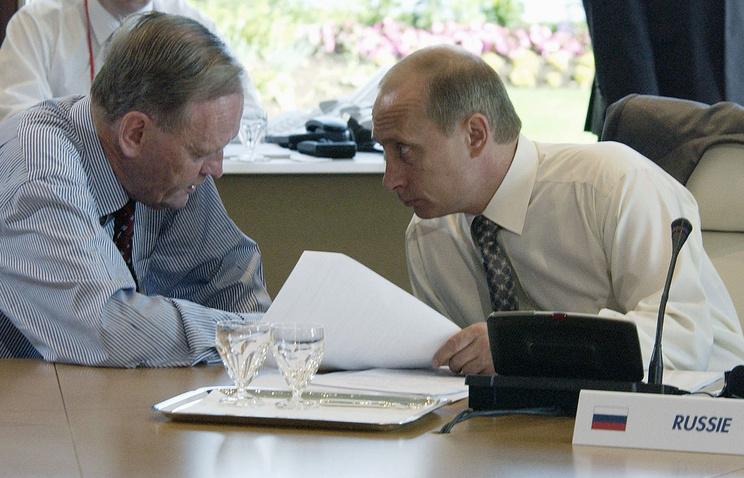Canada's Jean-Loup Chretien and Vladimir Putin in 2003