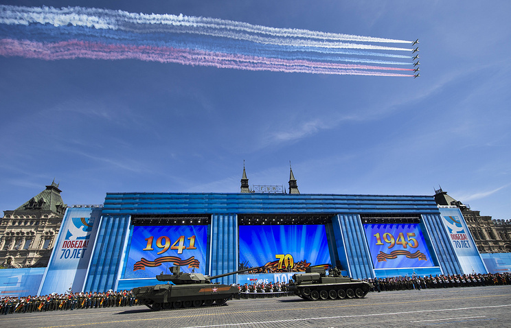 Russian military planes fly over, as Russian T-14 Armata tank is ready to be towed