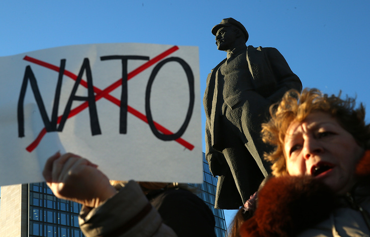 A woman holds a poster at a rally in east Ukraine's Donetsk