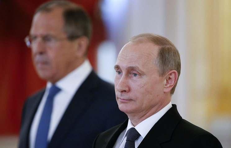 Russian President Vladimir Putin (right) at a ceremony of receiving diplomatic credentials from foreign ambassadors
