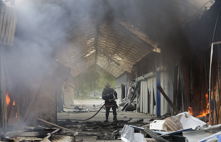 Aftermath of shelling at a market in the outskirts of Donetsk