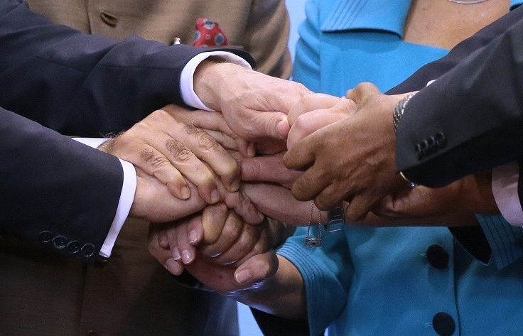 BRICS leaders shake hands at a summit in Brazil, 2014