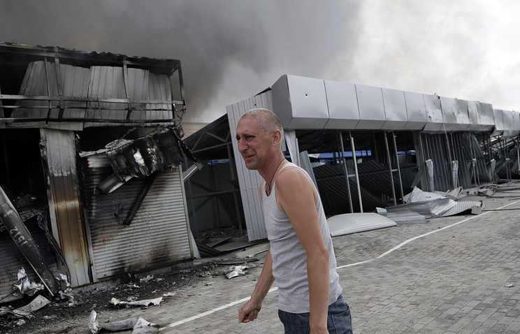 Buildings damaged after shelling at a market in the outskirts of Donetsk