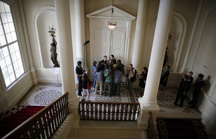 Journalists waiting at the closed doors in Vienna hotel where the talks between Iran and the six world powers continue