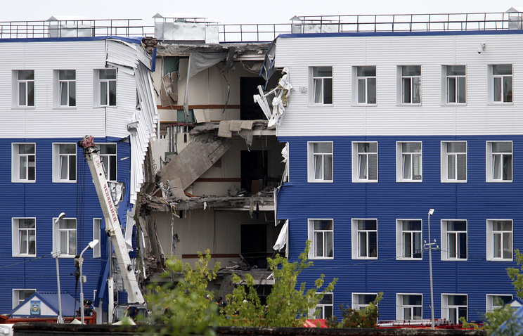 A military barrack with collapsed ceiling is seen at a base in Omsk, Russia, Monday, July 13, 2015