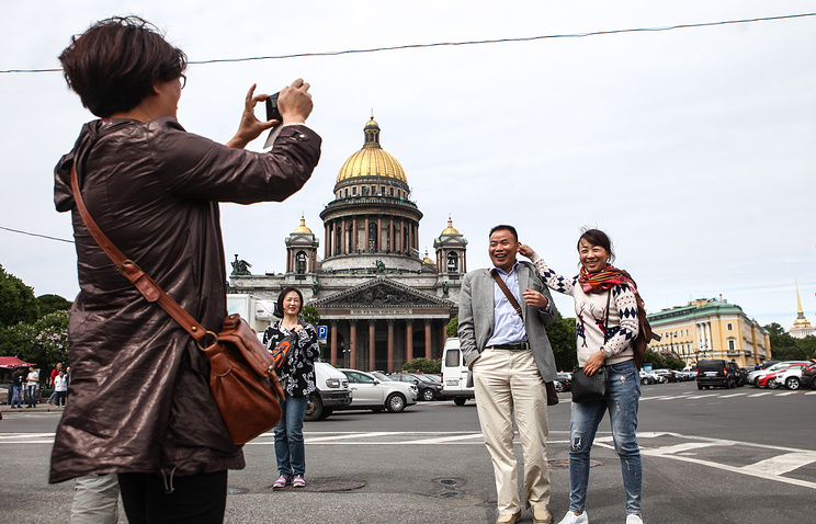Tousrists near St. Isaac's Cathedral in St. Petersburg