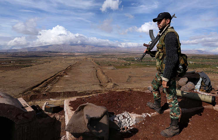 Syrian government army soldier on duty surveying the area