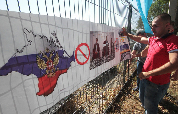Demonstrators outside the offices of ATR broadcasting company during a protest against food blockade of Crimea