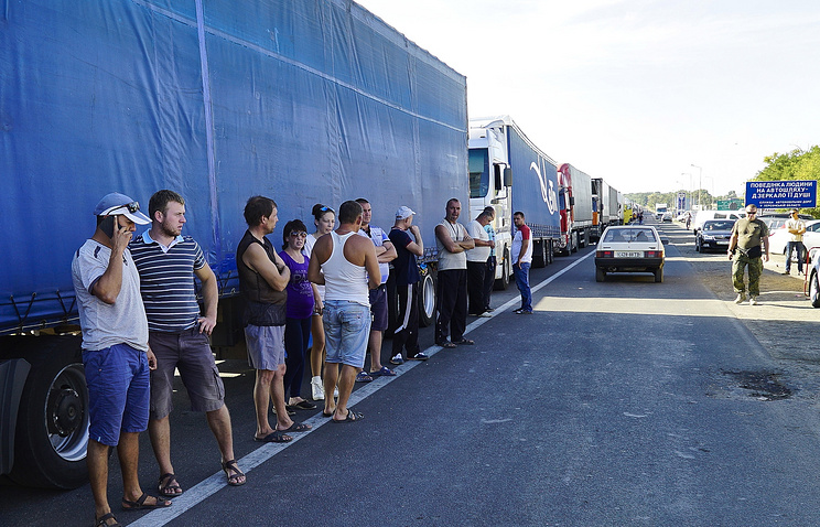 SEPTEMBER 20, 2015. Trucks and drivers at Chongar crossing on the border to the Crimea. Activists of the Right Sector, a Ukrianian far right movement, have blocked the motorway to prevent vehicles carrying food supplies from crossing the border.