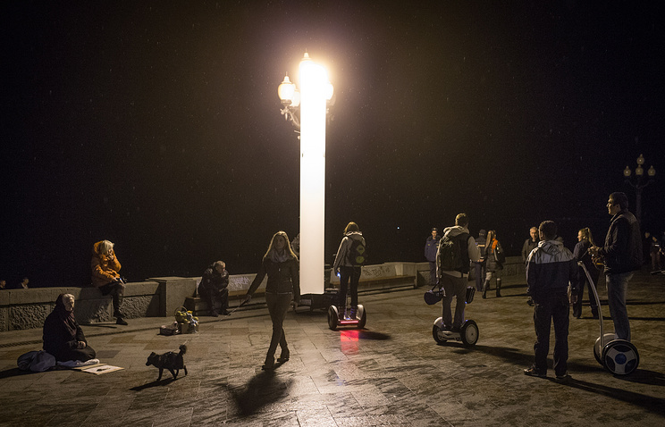 Yalta residents walking by the Black Sea, Crimea