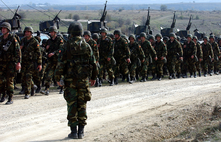 Macedonian army soldiers during a live ammunition military drill
