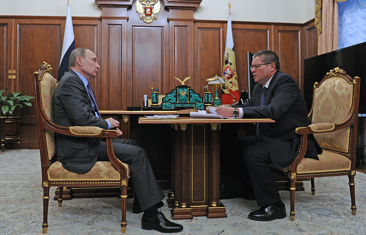 Russian President Vladimir Putin and Economic Development Minister Alexey Ulyukayev