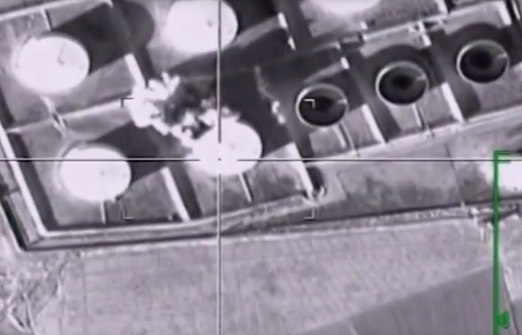 Footage taken from Russian Defense Ministry official web site showing fuel tanks hit during the attack of Russian warplanes in Syria