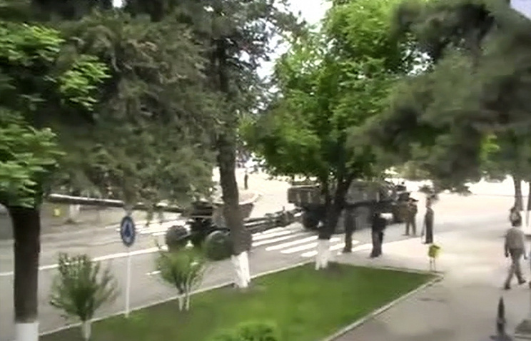 A howitzer is towed in a street in Stepanakert on April 3
