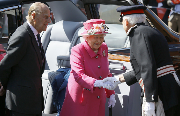 Britain's Queen Elizabeth II and The Duke of Edinburgh at The Royal Mail Post Office in Windsor