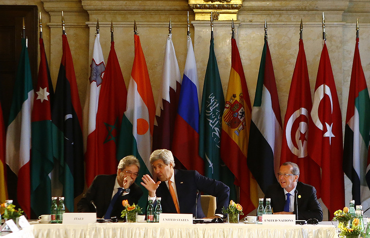 US Secretary of State John Kerry, Italian Foreign Minister Paolo Gentiloni and UN Libya envoy Martin Kobler at the ministerial meeting on Libya in Vienna