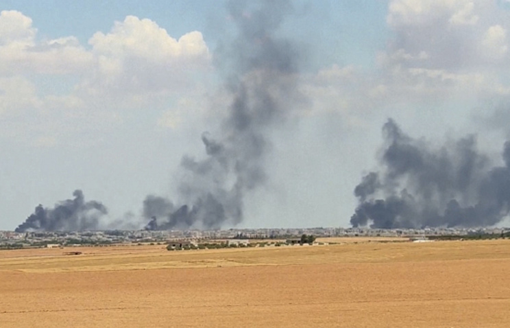 Smoke rising from the city of Manbij, Syria