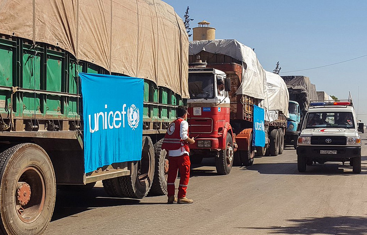An aid convoy of 31 trucks preparing to set off to deliver aid to the western rural side of Aleppo, Syria, 19 September 2016
