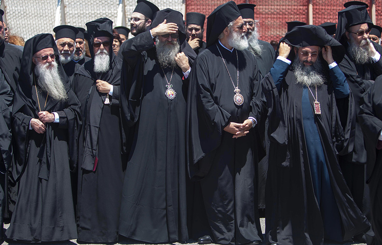 Senior Orthodox clergy at the airport of Chania in the Greek island of Crete