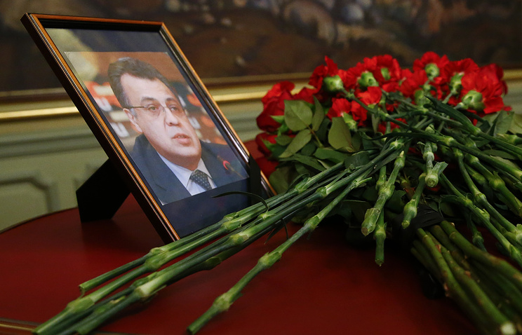 Flowers near a portrait of murdered Russian ambassador to Turkey Andrey Karlov