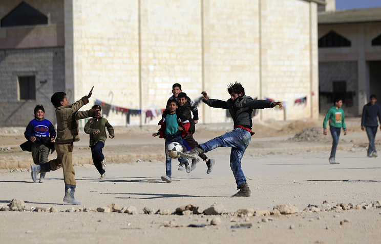 Children play soccer in the village of Jibreen south of Aleppo, Syria