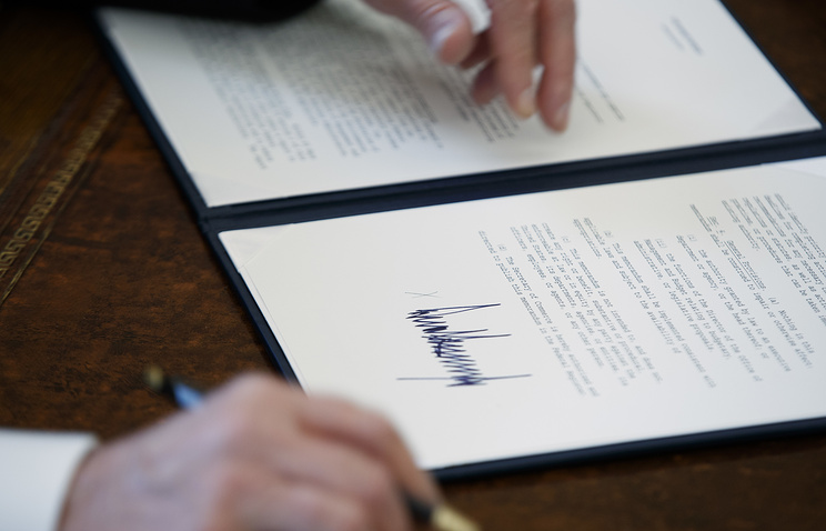 US President Donald Trump signing an executive order in Oval Office of the White House in Washington