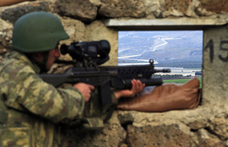 A Turkish army soldier at a military outpost near the town of Kilis, on the border with Syria