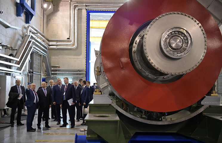 Russia's President Vladimir Putin visits the NPO Saturn facilities