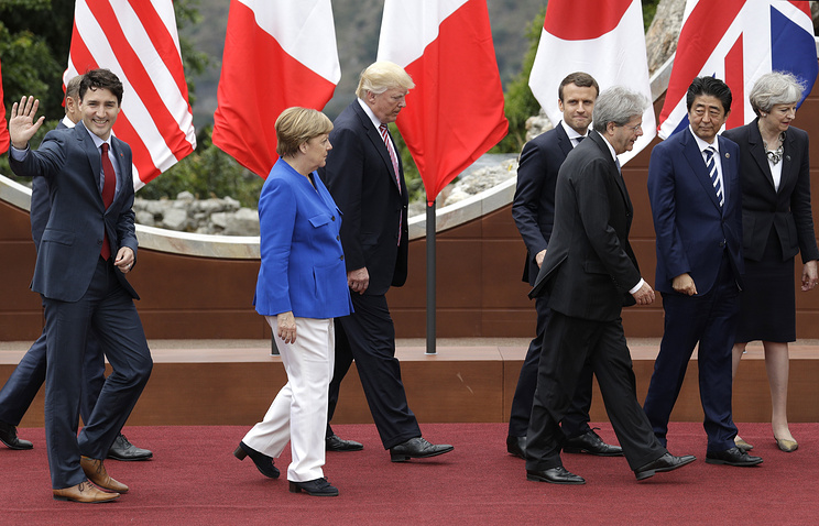 G7 leaders Canadian Prime Minister Justin Trudeau, German Chancellor Angela Merkel, US President Donald Trump, French President Emmanuel Macron, Italian Prime Minister Paolo Gentiloni, Japanese Prime Minister Shinzo Abe and British Prime Minister Theresa May