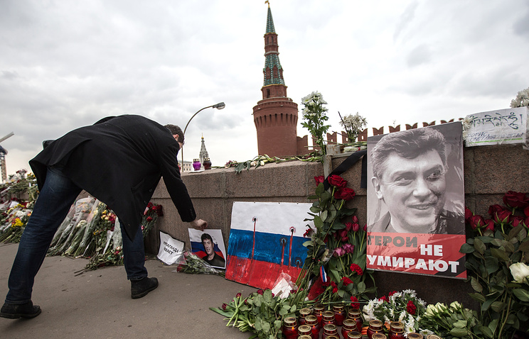 Flowers and candles left at a portrait of Boris Nemtsov in central Moscow, 2015