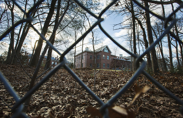 A fence encloses an estate in the village of Upper Brookville in the town of Oyster Bay, on Long Island, after the Obama administration closed this compound for Russian diplomats