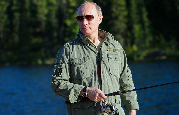 Russia's president Vladimir Putin during a fishing trip to a national nature reserve in Tyva, 2013