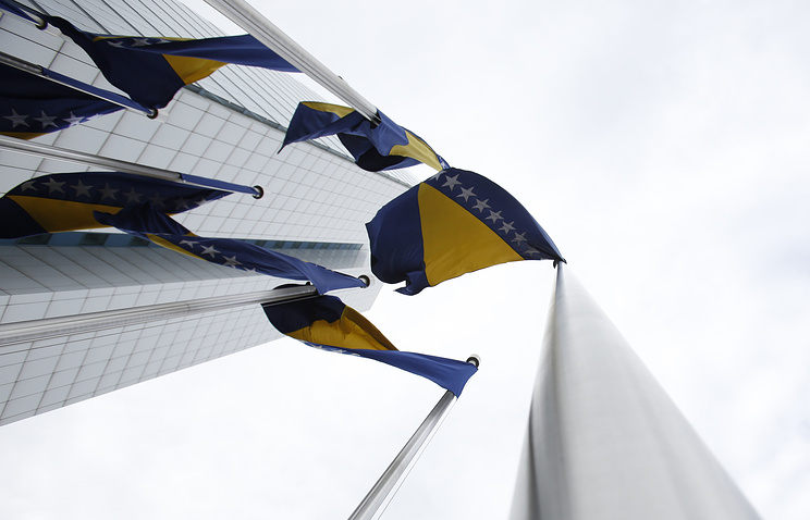 Bosnian flags near government building in Sarajevo