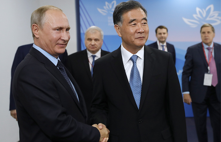 Russian President Vladimir Putin and Chinese Vice Premier Wang Yang