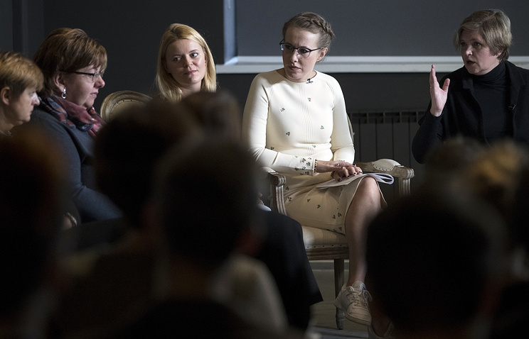 Russian presidential hopeful Ksenia Sobchak, second right, attends a meeting in Moscow