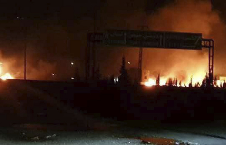 Flames rising after an attack in an area known to have numerous army military bases in Syria, May 9