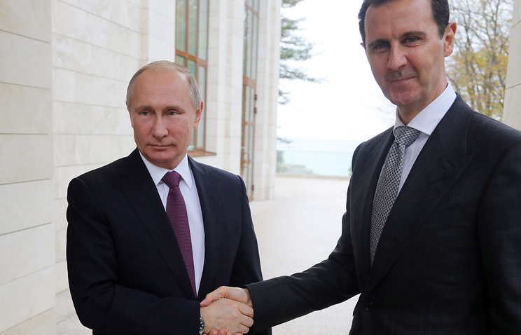 Russian and Syrian Presidents Vladimir Putin and Bashar al-Assad