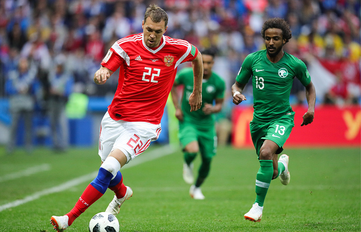 Russia's Artyom Dzyuba (L) and Saudi Arabia's Yasser Al-Shahrani in action in the 2018 FIFA World Cup opening match at Luzhniki Stadium