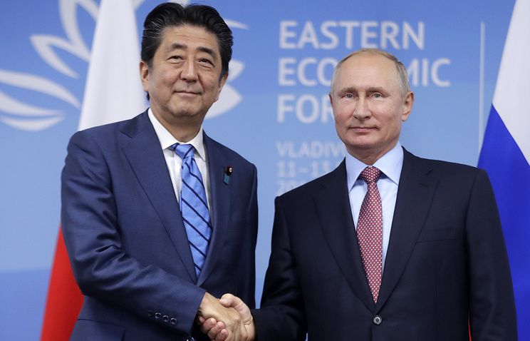 Abe and Putin meet, talk trade and peace treaty