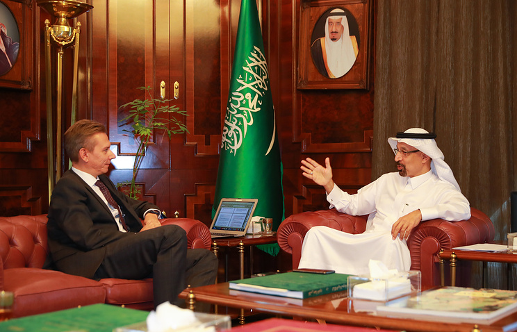 TASS Editor-in-chief Maxim Filimonov and Saudi Arabian Energy Minister Khalid al-Falih