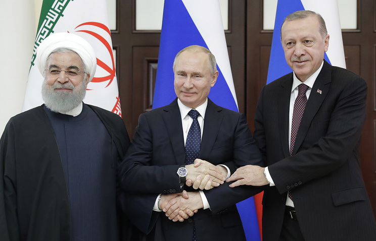 Iran's President Hassan Rouhani, Russia's President Vladimir Putin, and Turkey's President Recep Tayyip Erdogan (L-R) during trilateral talks to discuss prospects for Syrian peace process