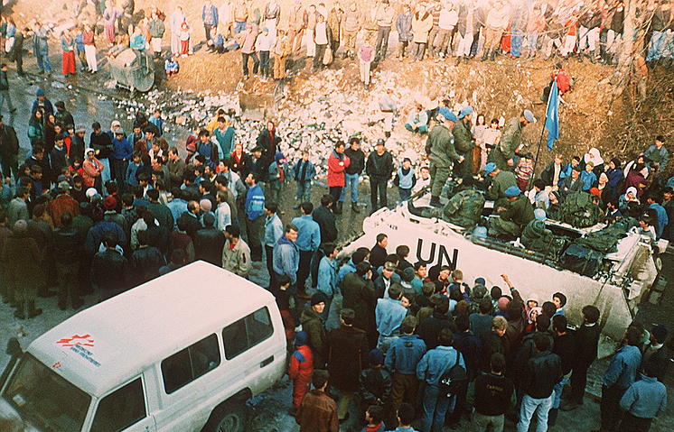Residents of the besieged Bosnian Muslim enclave of Srebrinica surround the UN armored vehicle of the commander of UN forces in Bosnia Phillipe Morillon as he tries to leave the town, 1993